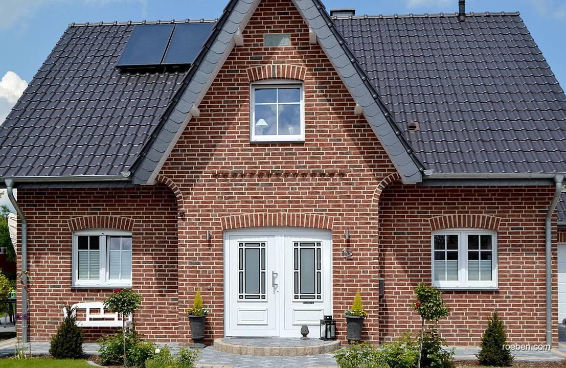красивая кирпичная кладка домов фото имеет необычную форму