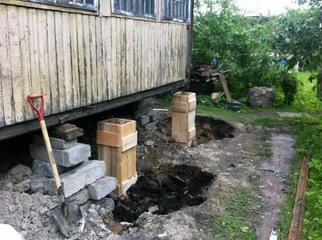 Ремонт фундамента под деревянным домом