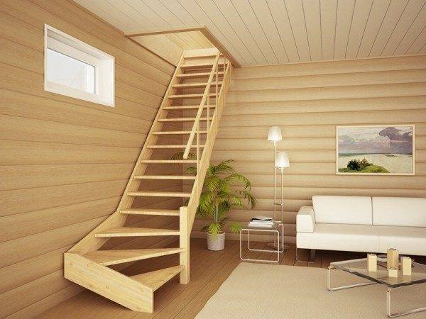 На фото деревянная лестница в мансардное помещение